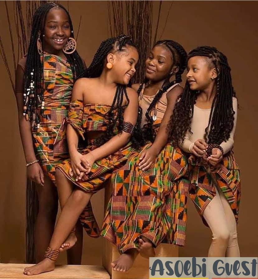 girls feeling fly in Kente fabric