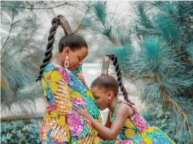 expectant women and daughter in colourful Ankara