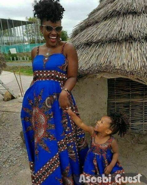 mom and daughter in blue ankara gown share laughter