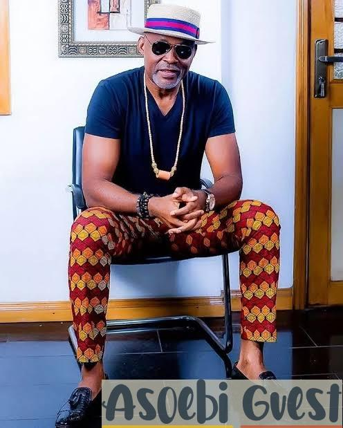 RMD in v-neck t-shirt and ankara trousers